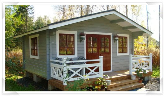 GardenLife's Deben log cabin painted in pale green and brown