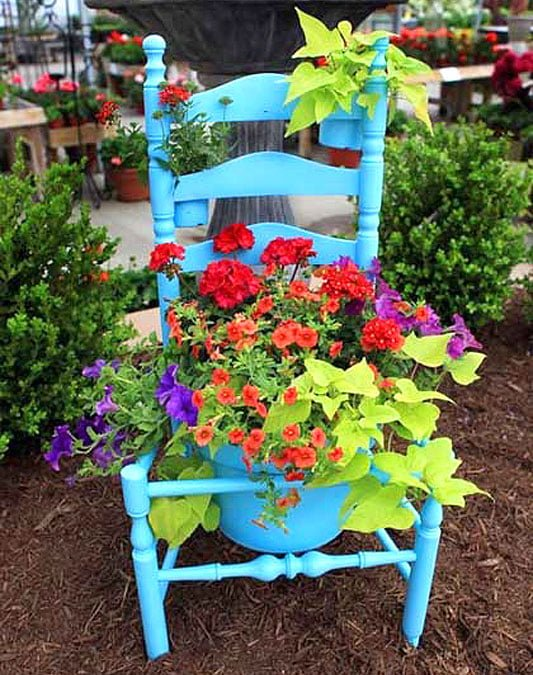 Colourful recycled chair planter