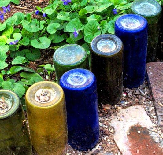 Garden border made from old wine bottles