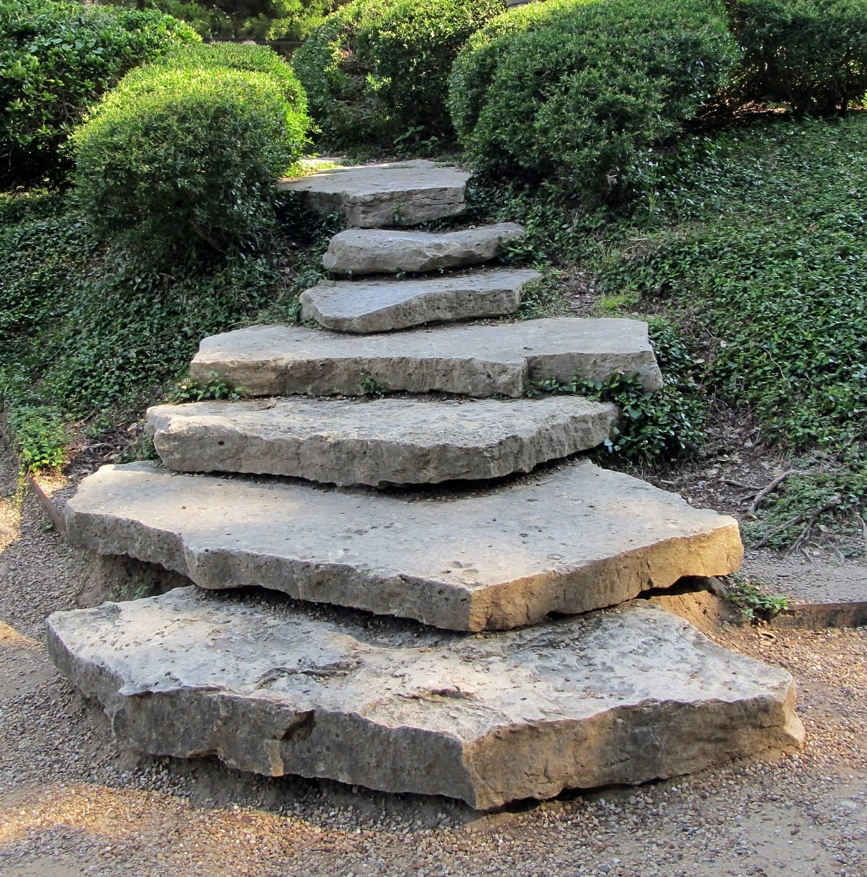 Using boulders to create steps to a garden path