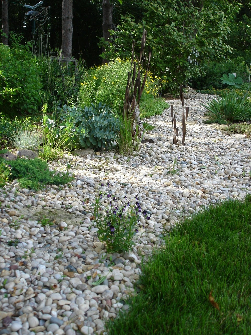 Create a shore line, divide, path or boundary with pebbles