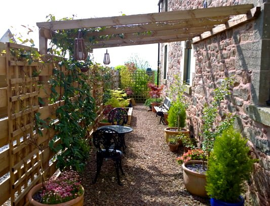 Garden fence with built in pergola
