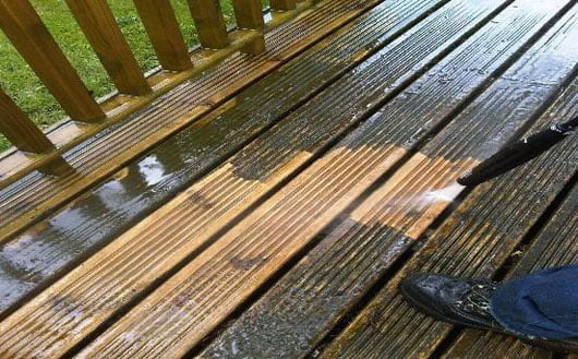 Clean decking and paving around garden sheds