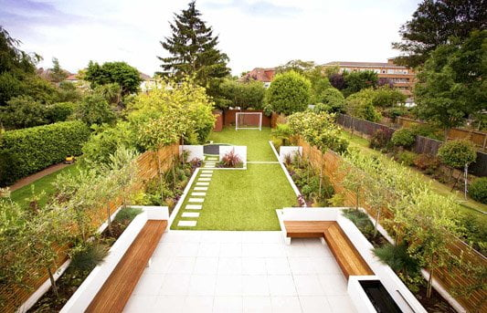 Long narrow zonal garden design with seating and kids area