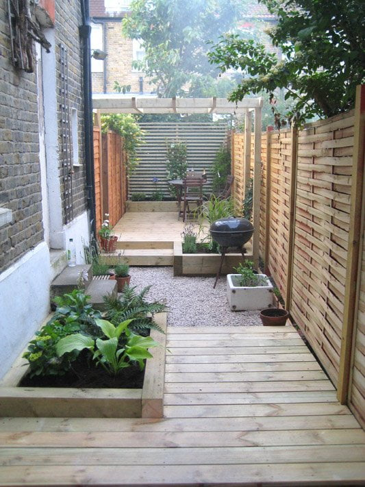 Long thin garden design with decking and a pergola