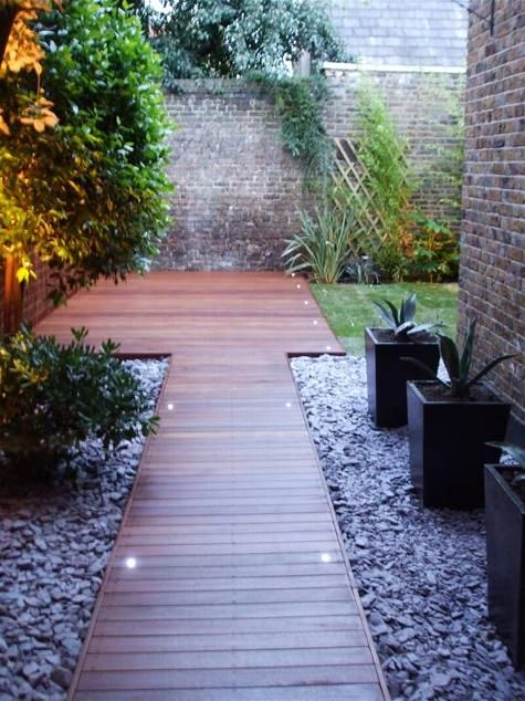 Classic garden decking BBQ and patio area